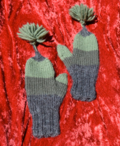 Long, pointed mittens with tassels.